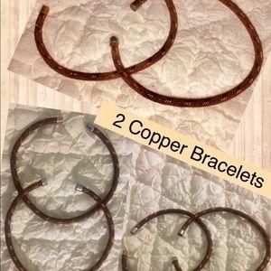 Two copper bracelets